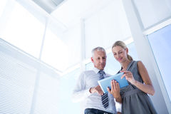 Business people discussing over a digital tablet Royalty Free Stock Photography