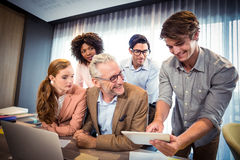 Business people discussing over digital tablet Royalty Free Stock Photography