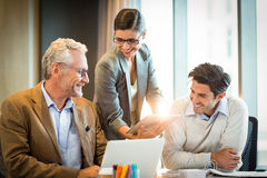 Business people discussing over digital tablet Royalty Free Stock Photo