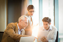 Business people discussing over digital tablet Stock Photo