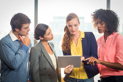 Business people discussing over digital tablet Royalty Free Stock Images