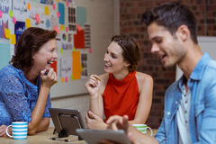 Business people discussing over digital tablet Royalty Free Stock Image