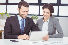 Business people discussing over digital tablet in office Royalty Free Stock Photography