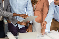 Business people discussing over digital tablet in office Royalty Free Stock Photos