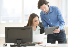 Business People Discussing Over Digital Tablet Stock Image