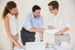Business people discussing over document Stock Images