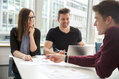 Business People Discussing Over Document In Office Stock Image