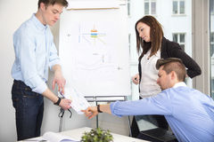 Business People Discussing Over Document In Office Stock Photos