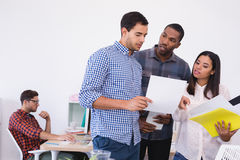 Business people discussing over document Stock Photography