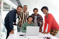 Business people discussing over laptop in the conference room at office. Portrait of diverse Business people discussing over laptop in the conference room at stock photo