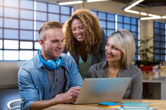 Business people discussing over laptop Royalty Free Stock Image