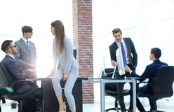 Business people discussing over new business project in office. Executives having friendly discussion during break royalty free stock photo