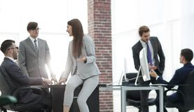 Business people discussing over new business project in office. Executives having friendly discussion during break stock photos