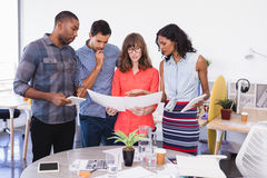 Business people discussing over paper Royalty Free Stock Photography