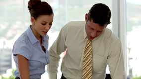 Business people discussing paperwork. At the office stock footage