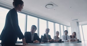 Business people discussing during presentation stock video footage