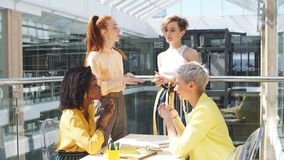Business people discussing project in background of office stock footage