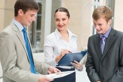 Business people discussing reports Stock Photo