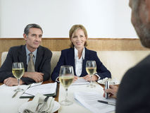 Business People Discussing In Restaurant Royalty Free Stock Photos