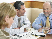 Business People Discussing In Restaurant Royalty Free Stock Image