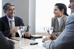 Business People Discussing At Restaurant Table Stock Images