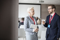 Business people discussing in seminar hall.  royalty free stock images