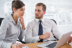 Business people discussing something on laptop Stock Images