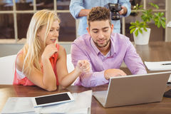 Business people discussing something using laptop Royalty Free Stock Images