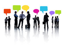 Business People Discussing And Speech Bubbles Royalty Free Stock Image