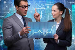 The business people discussing stock chart trends. Business people discussing stock chart trends royalty free stock image