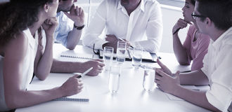 Business people discussing at table Stock Images