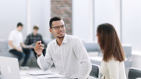 Business people discussing the terms of the contract sitting at the office table royalty free stock photo