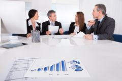 Business people discussing together Stock Image