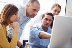 Business people discussing using laptop Royalty Free Stock Photography