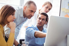Business people discussing using laptop Royalty Free Stock Photo