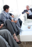 Business people discussing in a waiting room Royalty Free Stock Photos