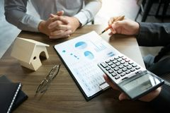 Business people discussion about contract of real estate sale stock image