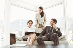 Business people in discussion in living room Stock Images
