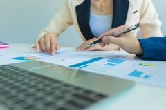 Business people discussion and summary financial information at meeting