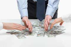 Business people distributing earnings Stock Photo