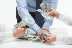 Business people distributing earnings Stock Image