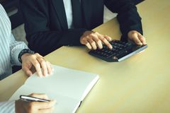 Business people doing finance analysis working together at home office.  stock images