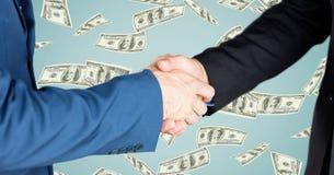 Business people doing handshake money in background. Digital composite of Business people doing handshake money in background Stock Photos