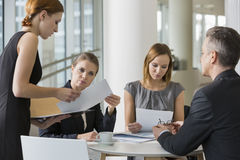 Business people doing paperwork in office cafeteria Stock Photo