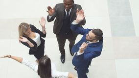 Business people doing a team building then putting their hands on top of each others. Slow motion stock footage