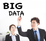 Business people drawing big data text Royalty Free Stock Photo