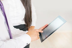 Business people dressed in white using tablet pc at office Royalty Free Stock Photos