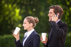 Business people drinking coffee outside. Royalty Free Stock Photo