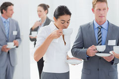 Business people drinking cup of coffee. In the meeting room Stock Photography