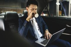 Business people drinking some beverage. In his car stock photography